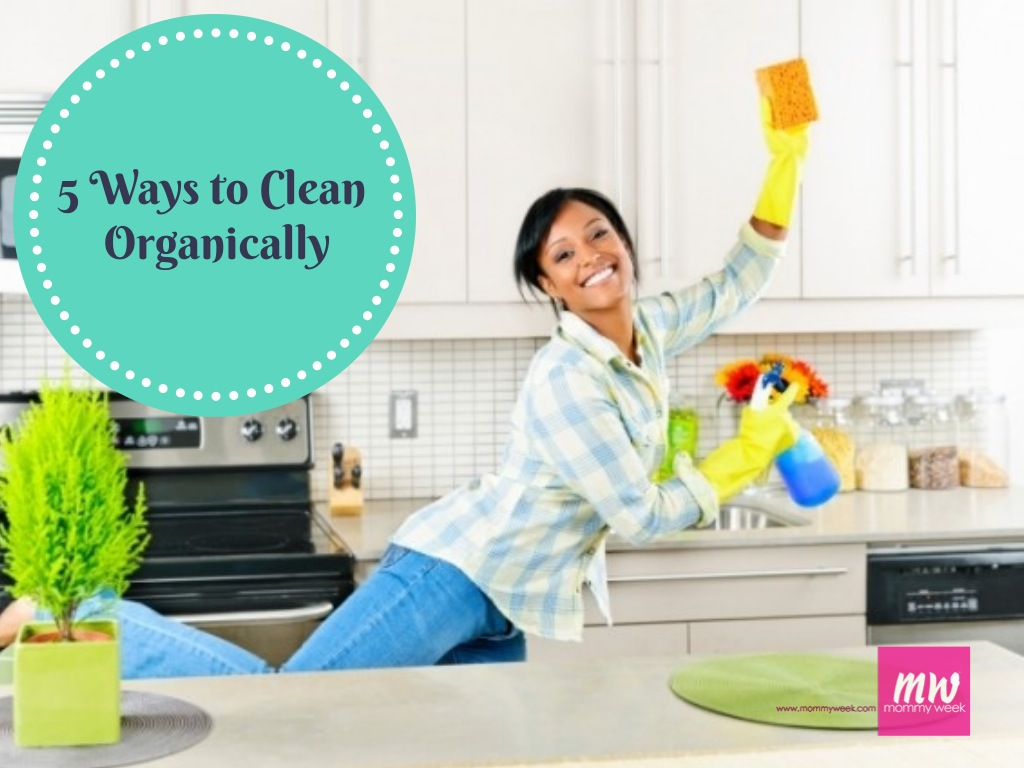 woman cleaning kitchen organically